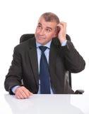 Business man pensive at the desk Stock Photos