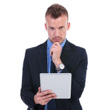 Business man pensive with tablet Royalty Free Stock Photography