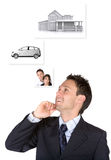 Business man with personal goals on the wall Stock Images