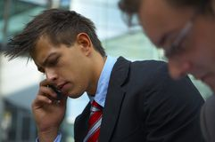 Business man on phone. Young business man is talking on his cell phone Stock Image