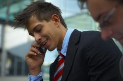 Business man on phone. Young business man is talking on his cell phone Stock Images