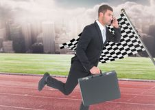 Business man on phone with briefcase and running on track against skyline with clouds and checkered. Digital composite of Business man on phone with briefcase Stock Photography