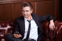 Business man with a phone Royalty Free Stock Images