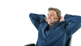 Business man on phone or customer service representative. Business or sales man on phone or customer service representative helping customers in a relaxed pose Stock Image