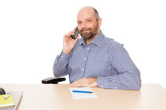 Business man at the phone. A handsome business man at the phone isolated on white background Stock Photos