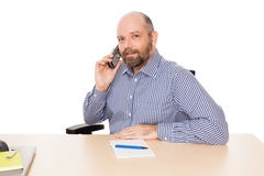 Business man at the phone. A handsome business man at the phone isolated on white background Royalty Free Stock Photo