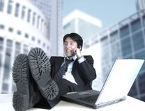 Business man on the phone in his office Royalty Free Stock Image