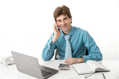Business man with phone and laptop Stock Photo