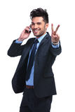 Business man on the phone  making the victory sign Royalty Free Stock Photo