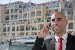 Business Man on the phone at the Marina Stock Images