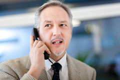 Business man at the phone Royalty Free Stock Image