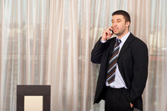 Business man with phone mobile in office Royalty Free Stock Image