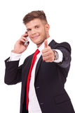 Business man on phone thumb up Stock Photo