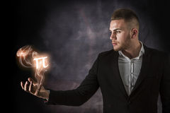 Business Man With PI on Fire Stock Photo
