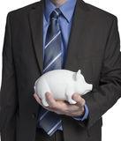 Business man with piggy bank Stock Image