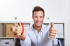 Business man with piggy bank Stock Photo
