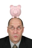 Business Man with Piggy Bank on head Royalty Free Stock Images