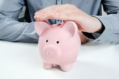 Business man with piggy bank. Stock Image