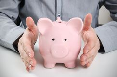 Business man with piggy bank. Stock Photos