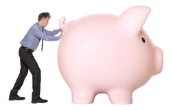 Piggy bank and businessman Stock Image