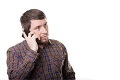 Business man in a plaid shirt talking on the phone isolated on w Stock Photo