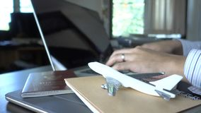 Business man is planning his Business travel. In office stock footage