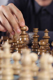 Business man playing chess. Wearing a shirt Royalty Free Stock Photography