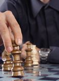 Business man playing chess royalty free stock images
