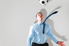 Business man is playing football Royalty Free Stock Photography