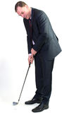 Business man playing golf Royalty Free Stock Images