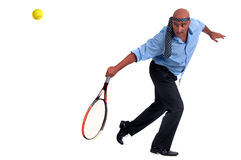 Business man playing tennis Stock Images