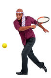 Business man playing tennis Stock Image