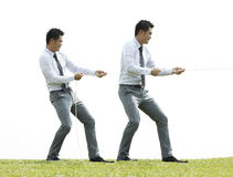 Business man playing tug of war Royalty Free Stock Photography