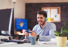 Business man playing videogames in his office Royalty Free Stock Photo