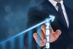 Business man point hand on the top of arrow graph with high rate of growth. The success and growing growth graph in the company or stock photos