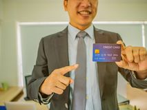 Business man point to credit card royalty free stock images