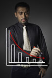 Business man point to falling graph Royalty Free Stock Photo