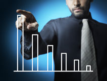 Business man point to graph Stock Photography