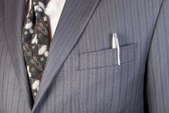 Business man point to pen in the pocket Stock Photos