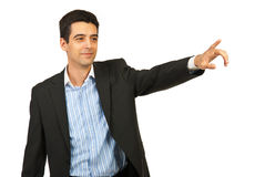 Business man pointing away Royalty Free Stock Photography