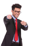 Business man pointing with both hands. Young business man pointing towards the camera with both hands and smiling, isolated on a white background royalty free stock photography
