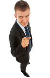 Business man pointing at camera. Wide angle picture of a business man pointing at camera stock images