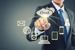 Business man pointing at cloud computing royalty free stock photography