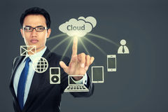 Business man pointing at cloud computing Royalty Free Stock Images
