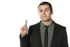 Business man pointing at copy space Royalty Free Stock Image