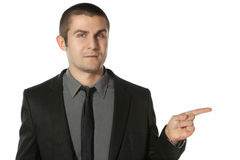 Business man pointing at copy space Royalty Free Stock Photos