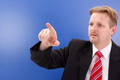 Business man pointing on copy space Stock Images