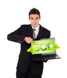 Business man pointing at eco laptop Royalty Free Stock Photos