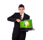 Business man pointing at eco world Royalty Free Stock Photo