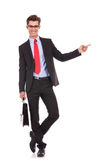 Business man pointing finger to his left side Stock Photos